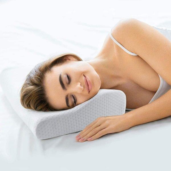Woman using occipital neuralgia pillow